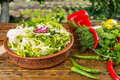 Fresh bowl of salad greens on table Royalty Free Stock Photo
