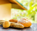 Fresh bread on black wooden table on rural landsca landscape background Stock Photography