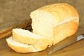 Fresh bread loaf of with thick cut slices on a brown background Royalty Free Stock Photos