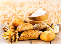 Fresh bread with wheat ears on wooden table Royalty Free Stock Photos