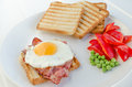 Fresh breakfest ham eggs vegetable and toast homemade Royalty Free Stock Photos