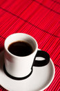 Fresh brewed coffee over red background close up Stock Images