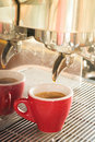Fresh brewing hot coffee from espresso machine with vintage filt filter effect stock photo Stock Photos