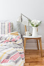 Fresh and bright bedroom decor decorated with a bouquet of flowers Royalty Free Stock Images