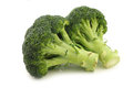 Fresh broccoli florets on a white background Royalty Free Stock Photo