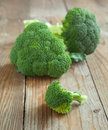 Fresh brocolli on wooden background Stock Photos