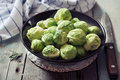 Fresh brussels sprout in bowl on wooden background Stock Photography