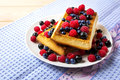 Fresh brussels waffle with blueberry, raspberry and blackcurrant Royalty Free Stock Photo