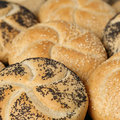 Fresh buns from bakery with poppy seeds and sesame Stock Photos