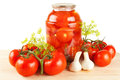 Fresh and canned tomatoes homemade preserves in glass jar Royalty Free Stock Photo