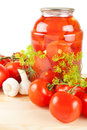 Fresh and canned tomatoes homemade preserves in glass jar Royalty Free Stock Photography