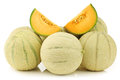 Fresh cantaloupe melons and a cut one on white background Royalty Free Stock Photo