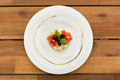 Fresh caprese tartar in glass plate on a wooden table Stock Photo