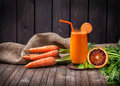 Fresh carrot and orange juice Royalty Free Stock Photo