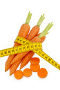 Fresh carrots with tape measure organically grown fruit and vegetables are always healthy symbolic photo for a healthy diet Royalty Free Stock Images