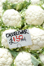 Fresh cauliflowers for sale priced at euro each Stock Photo