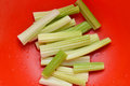 Fresh celery sticks red bowl closeup Royalty Free Stock Photography