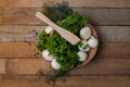 Fresh champignons and parsley in old plate with some dill peppercorn Royalty Free Stock Photo