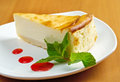 Fresh cheesecake with mint and topping Stock Image