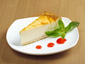 Fresh cheesecake with mint and topping Royalty Free Stock Image