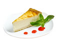 Fresh cheesecake with mint and topping isolated on white background Royalty Free Stock Photos