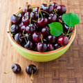 Fresh cherries in bowl on table Stock Image