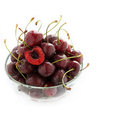 Fresh cherries in glass bowl over light background selective focus copy space Royalty Free Stock Photos