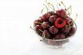 Fresh cherries in glass bowl over light background selective focus copy space Stock Photography