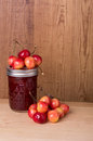 Fresh cherries with jam on table Royalty Free Stock Image