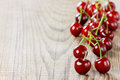 Fresh cherries on old wooden table rustic Stock Photo