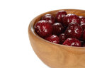 Fresh cherries in a wooden bowl on white background macro photo Royalty Free Stock Photo