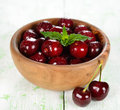Fresh cherries in a wooden bowl Royalty Free Stock Photo