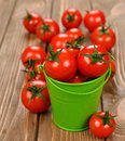 Fresh cherry tomatoes on a brown background Royalty Free Stock Images