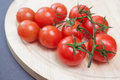 Fresh cherry tomatoes closeup brunch on wooden cutting board Stock Photography