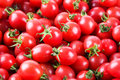 Fresh cherry tomatoes closeup of the delicious fruit background Stock Photo