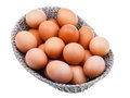 Fresh chicken eggs in wicker basket isolated on white background Royalty Free Stock Images