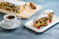Fresh Christmas Stollen With Raisins And A Cup Of Coffee.