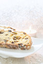 Fresh Christmas Stollen on a white plate. Royalty Free Stock Photo