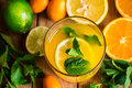 Fresh citrus lemonade from oranges lime fresh mint in glass, top view, vibrant colors, spring detox Royalty Free Stock Photo