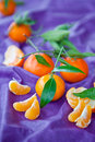 Fresh clementines on purple Royalty Free Stock Photos