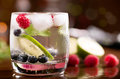 Fresh cocktail with mint and berries on the brown table Royalty Free Stock Photo