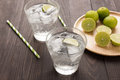 Fresh cocktail with soda, lime on a wooden background Royalty Free Stock Photo