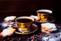 Fresh coffee black and homemade cookies selective focus on the front cup Royalty Free Stock Image