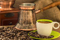 Fresh coffee with Turkish coffee pot at roasted bio coffee beans Royalty Free Stock Photo