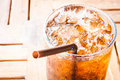 Fresh cola drink with ice on wood table Royalty Free Stock Photography
