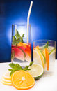 Fresh cold cocktail in glass with sliced citus cituses Royalty Free Stock Images