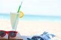 Fresh cold lemonade on a sunny beach Royalty Free Stock Photo