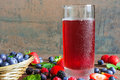 Fresh cold summer berries juice in a glass Royalty Free Stock Photo