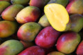 Fresh colorful mangoes at outdoor fruit market tropical on display farmers in rio de janeiro brazil Stock Image