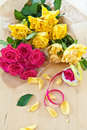 Fresh colorful roses yellow and pink on wooden table Royalty Free Stock Photo